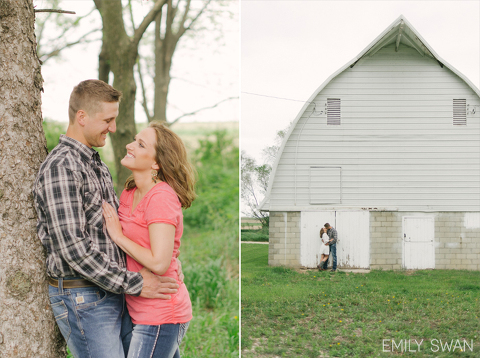 Larchwood Iowa rustic barn engagement photography couple smiling against tree and white barn outside