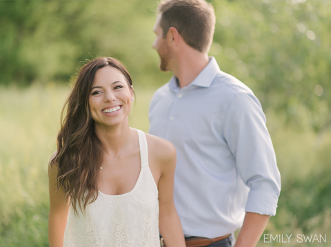 Romantic minimalist sunset prairie engagement couple in tall grass candid
