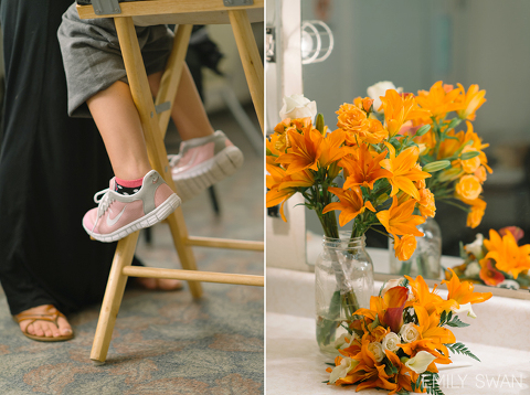 Detail of bride's pink sneakers in makeup chair and tiger lily wedding bouquets