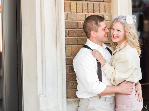 Candid laughing couple Sioux Falls vintage themed engagement photographer
