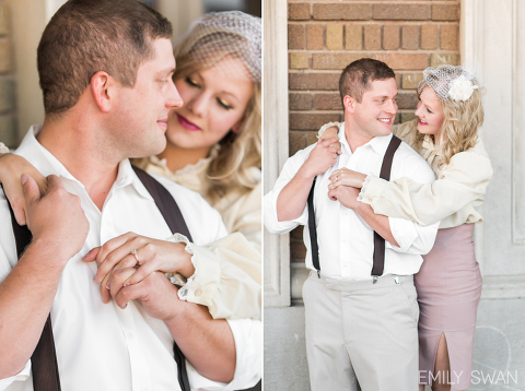 Couple smiling in vintage clothes in front of brick building fun themed engagement session