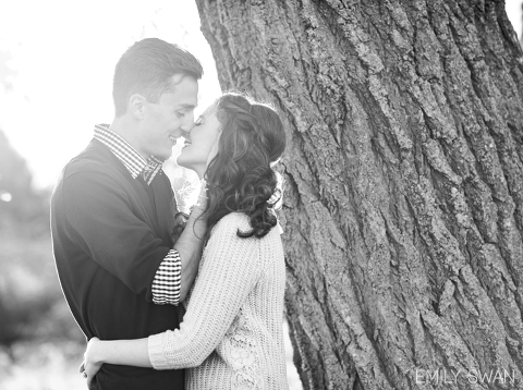 Natural light romantic Sioux Falls engagement photographer black and white portrait couple kissing by Emily Swan photography