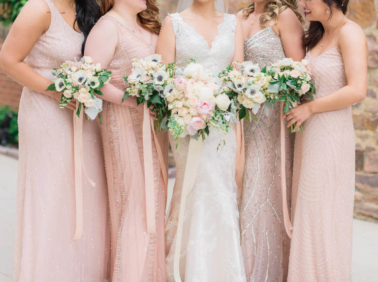 Pink bridesmaids dresses and bride bouquet detail