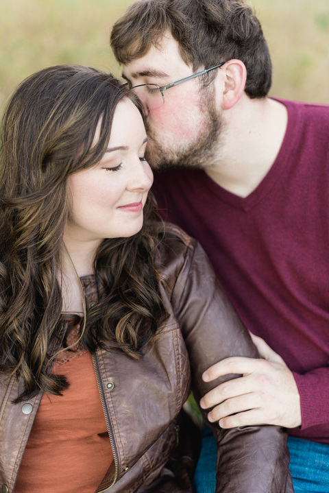 Close up of couple cuddling on Lake Mitchell South Dakota engagement