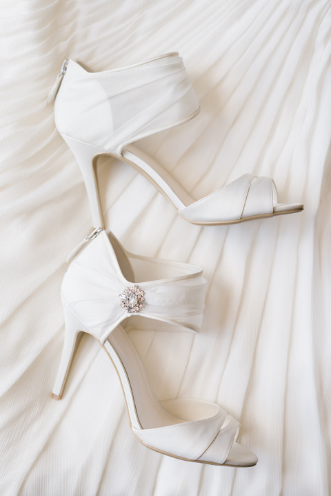 Ankle cuff ivory wedding shoes with zipper and crystal accent