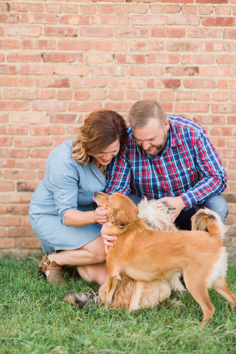 Couple with their dogs relaxed and casual engagement pictures