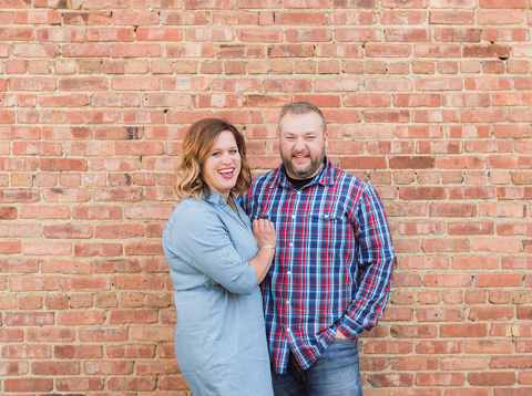 Engaged South Dakota couple with brick building picture
