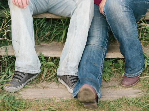 Feet picture of couple sitting on wooden park staircase
