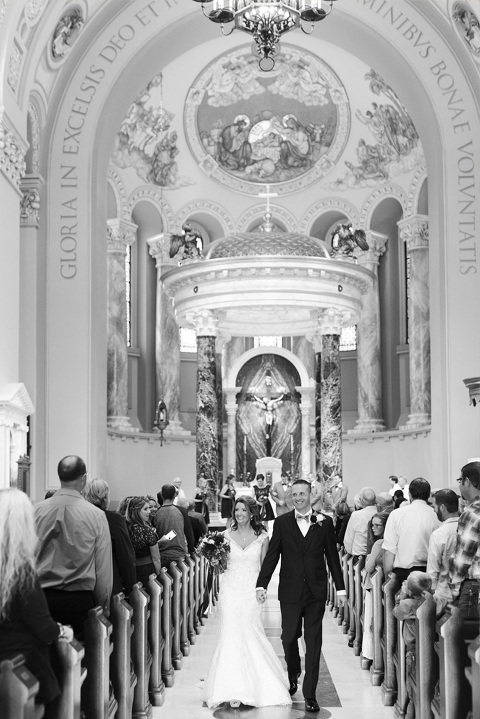 Bride and groom exit wedding ceremony St. Joseph's Cathedral Sioux Falls