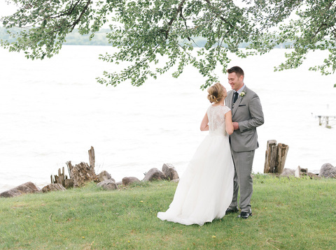 Wedding day first look on lake shore