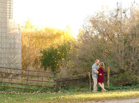 Couple with rustic fence and fall colors Milbank SD engagement
