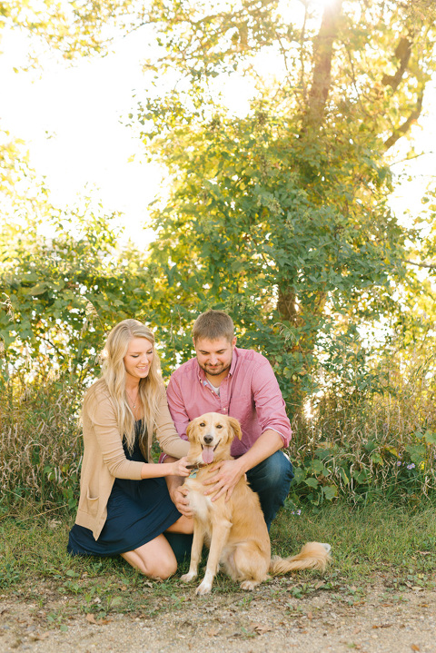 Couple with yellow lab mix Minnesota engagement pictures