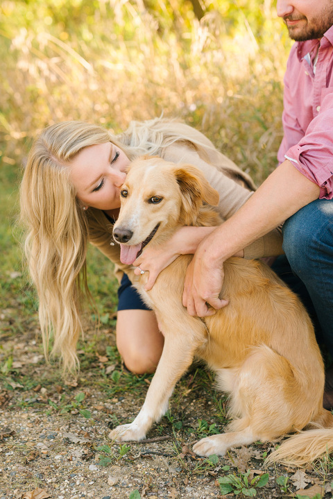 Woman kissing pet dog MN engagement photographer