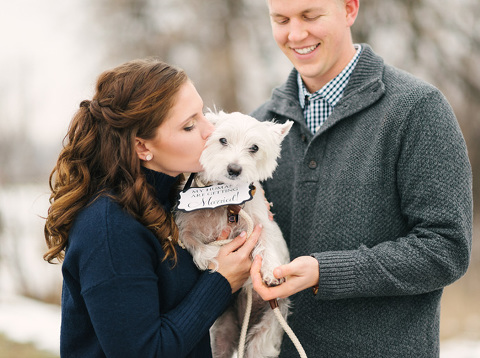 Girl kissing dog with My Humans Are Getting Married sign