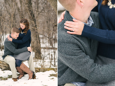 Couple sitting on log winter snow Midwest engagement