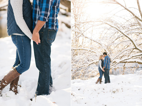 Couple holding hands and kissing in snow