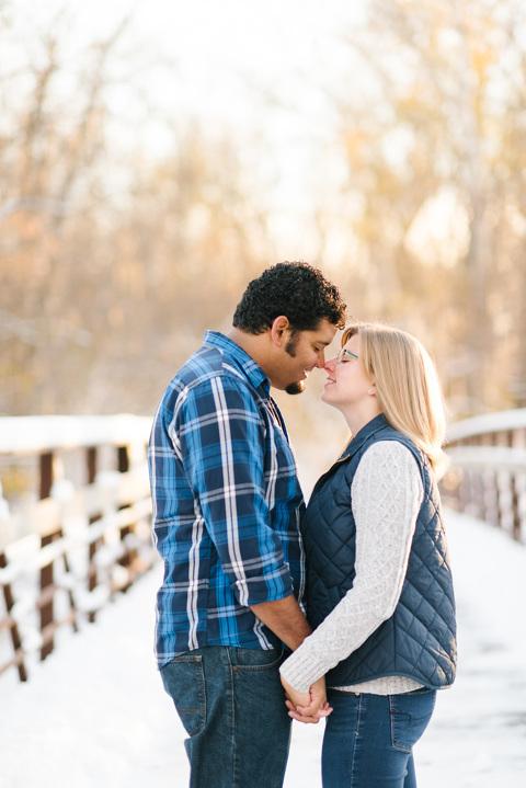Romantic engagement picture on bridge in winter
