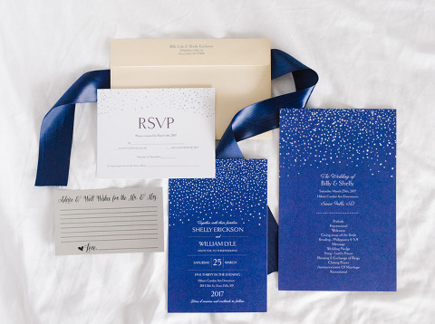 Navy blue, white, and silver wedding stationery suite