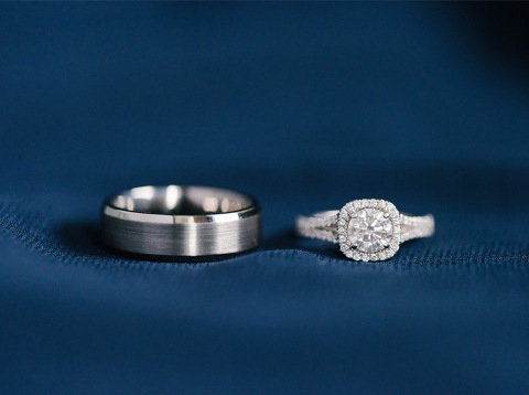 Close up of silver wedding ring set halo diamond ring
