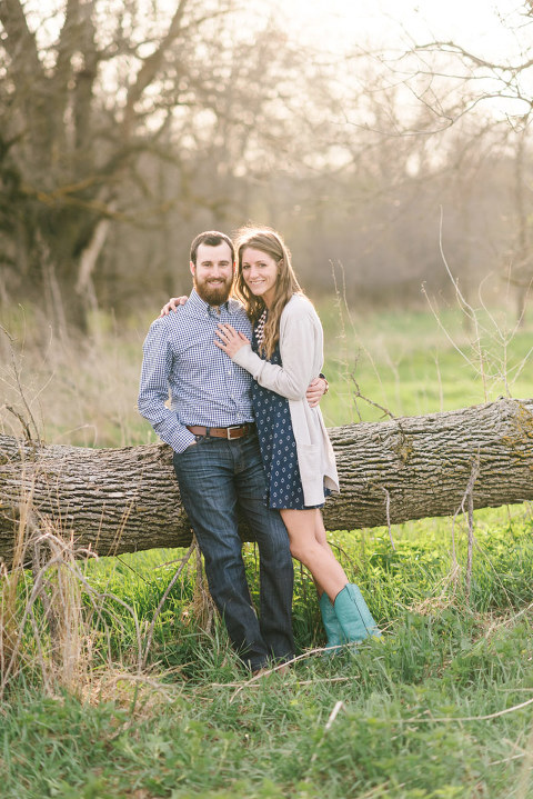 Nature reserve engagement photo couple by downed tree
