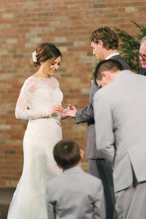 Bride And Groom Exchanging Rings Sioux Falls Wedding Photography
