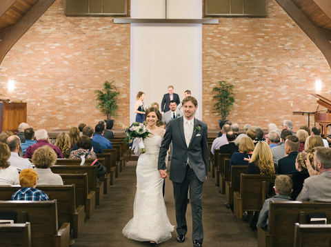 Bride and groom exit as man and wife church wedding