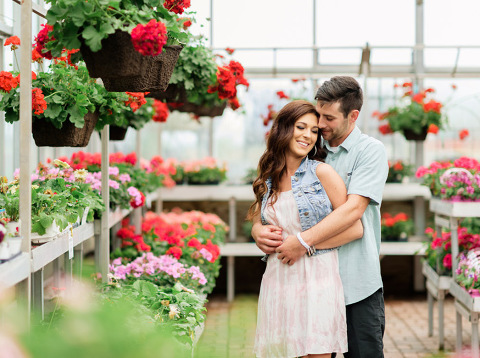 Romantic Sioux Falls engagement photography in greenhouse