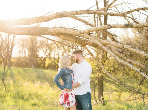 Couple together under tree sunset engagement in Sioux Falls