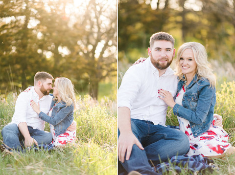 Beautiful sunset engagement Sioux Falls couple sitting in grass