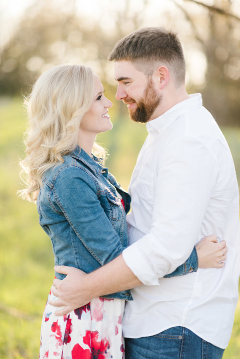 Bright pastel Midwest engagement photography couple embracing
