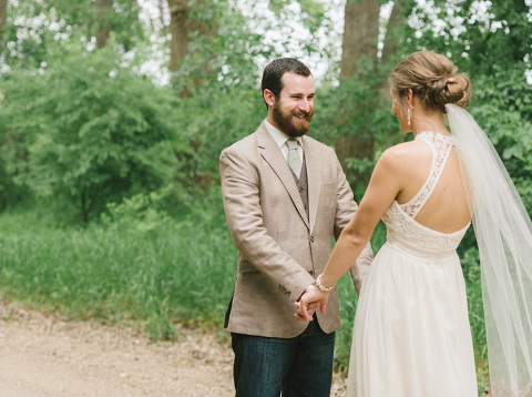 Wedding day first look outdoors on quiet country road Midwest wedding