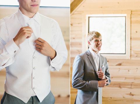 Groom getting dressed grey tuxedo Meadow Barn wedding