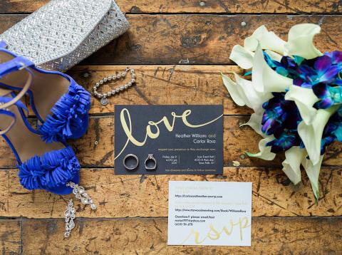 Blue and metallic wedding details lay flat love wedding invitation