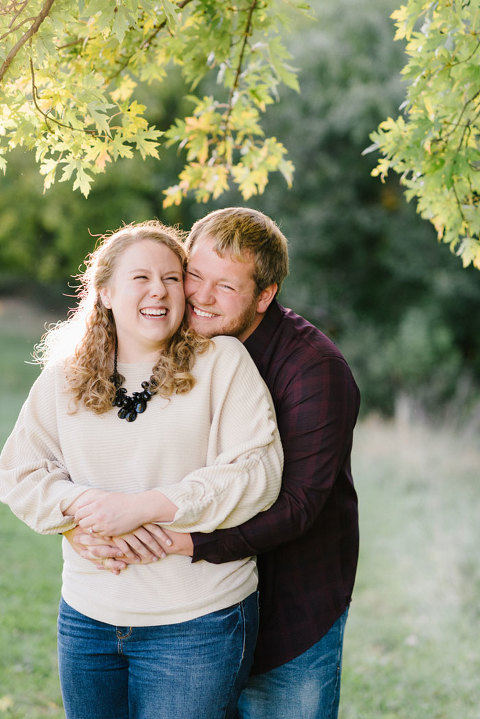 Loving and candid engagement photography couple laughing Emily Swan