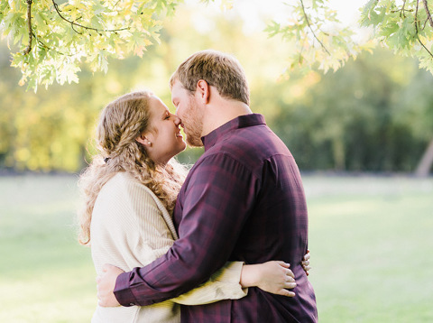 Romantic fine art engagement session at sunset Sioux Falls park