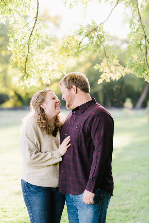 Natural and candid couple laughing Emily Swan photography engagement