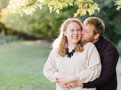 Candid and natural autumn engagement Sioux Falls Emily Swan wedding photographer