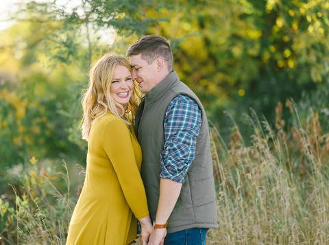 Unposed engagement picture couple genuine laughing romantic film colors