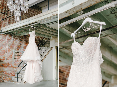 Wedding dress on custom bride hanger in brick warehouse Yankton wedding photography