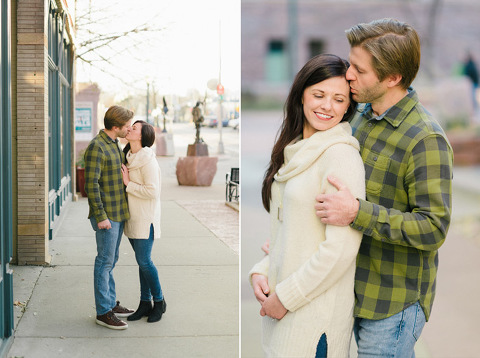 Couple kissing on sidewalk downtown Sioux Falls Sculpture Walk engagement