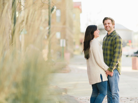 Engaged couple laughing winter downtown Sioux Falls photography