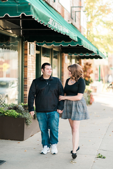 Engagement couple walking Sioux Falls, SD downtown 8th & Railroad Center