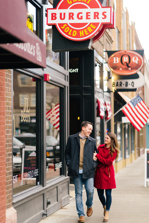 Couple walking together downtown Sioux Falls Phillips Ave engagement