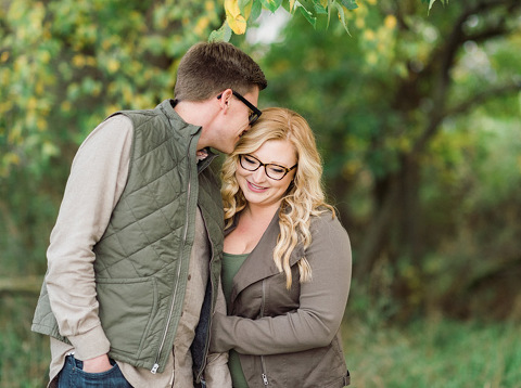 South Dakota couple with glasses fall colors engagement photography on lake