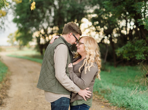 Autumn engagement photography South Dakota country road poses