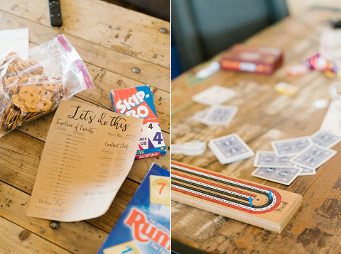 Games snacks cards and wedding timeline on kraft paper on farm tables