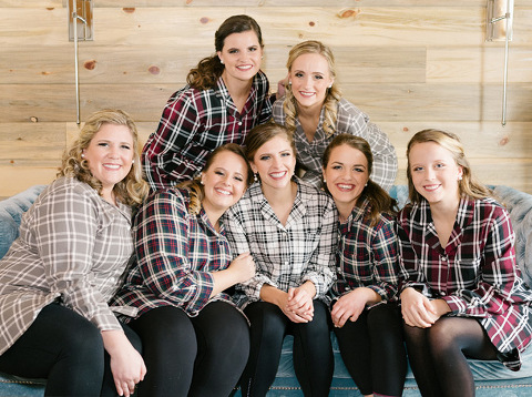 Bride with bridesmaids in flannel and leggings Meadow Barn Sioux Falls wedding