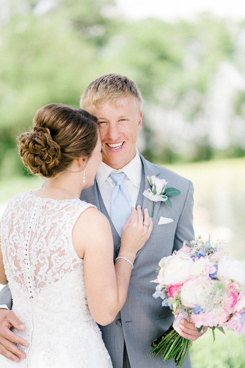 Candid wedding photography groom and bride laughing natural bright colors Emily Swan Photography