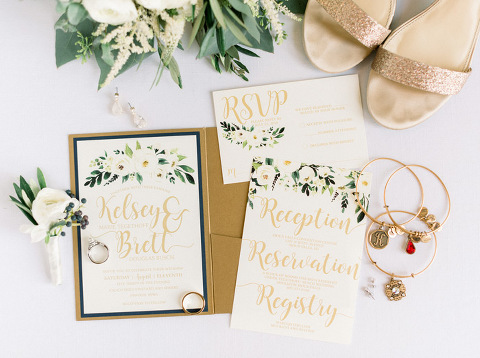 White floral greenery wedding invitation suite with gold details lay flat Inwood Iowa photography