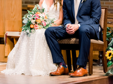 Groom with fun socks Olive & Grace Floral Co. coral and pink lush bouquet Sioux Falls church wedding photography
